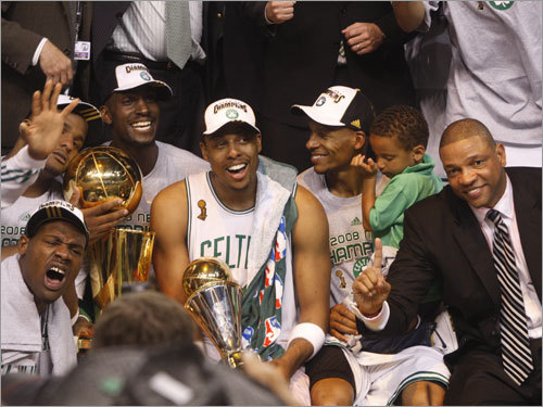 Kevin Garnett (left), Paul Pierce, Ray Allen, and Doc Rivers (right) posed for photos during celebrations.