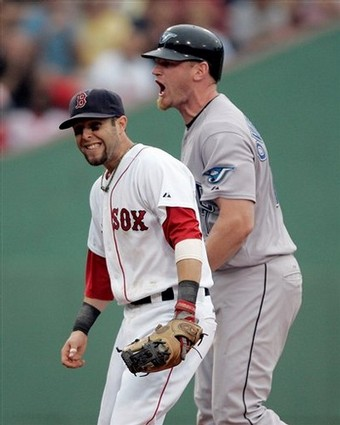 Boston Red Soxs Dustin Pedroia, left, smiles as Toronto Blue Jays Lyle Overbay protests being called out at second base in the ninth inning of a baseball game, Sunday, Sept. 14, 2008, in Boston. The Red Sox won 4-3. (AP Photo/Michael Dwyer)